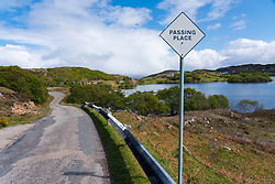 Passing place on highway on the North Coast 500 tourist motoring route in northern Scotland, UK