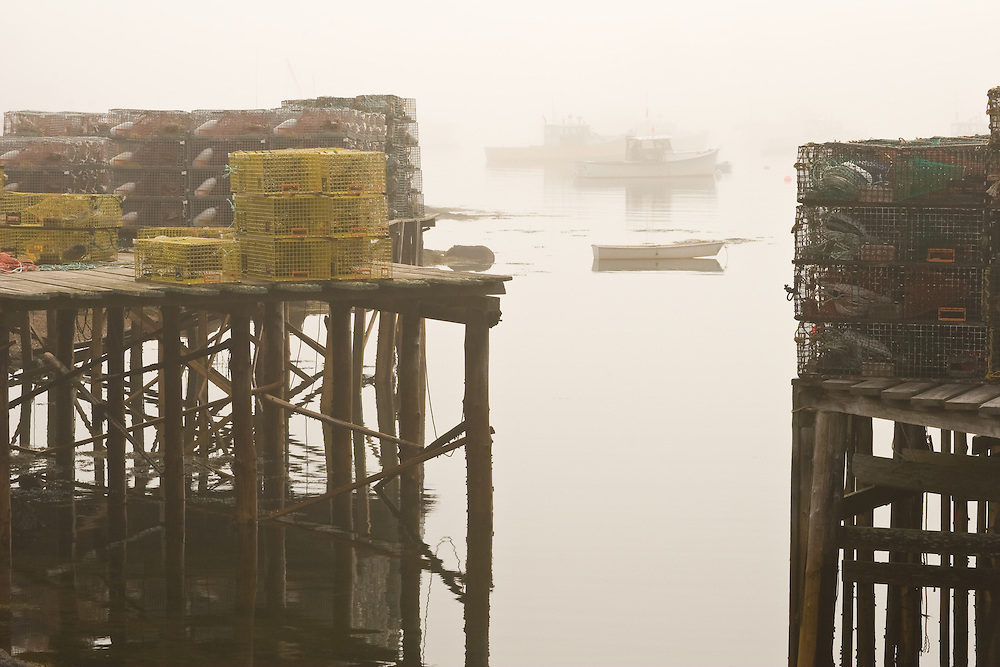 Fog settles over the quiet harbor of Corea along the Maine coast.