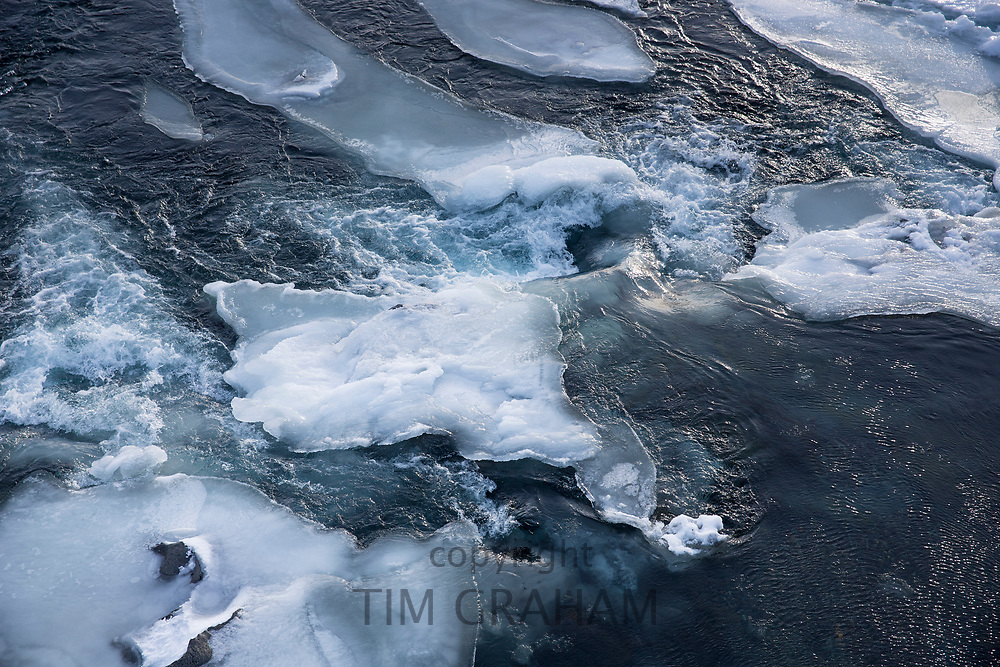 Floating iceberg as ice sculpture shapes in glacial water in South Iceland