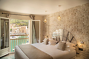 Bed in bedroom in Hotel Solamere with sea view, Bonifacio, Corsica, France