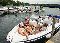 Caroline White, Claudia Bauman, Meghan O'Connor and Grace Quinn enjoy a day on the water in Wolfeboro, NH.  ©2106 Karen Bobotas Photographer