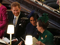 The Duke and Duchess of Sussex with the Princess Royal at the wedding of Princess Eugenie to Jack Brooksbank at St George's Chapel in Windsor Castle.