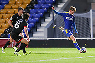 AFC Wimbledon midfielder Jack Rudoni (12) shoots at goal during the EFL Sky Bet League 1 match between AFC Wimbledon and Lincoln City at Plough Lane, London, United Kingdom on 2 January 2021.