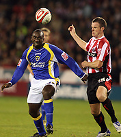 Photo: Paul Greenwood.<br />Sheffield United v Cardiff City. Coca Cola Championship. 02/10/2007.<br />Cardiff's Jimmy Floyd Hasselbaink, (L) and Michael Tonge battle for the ball