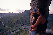 """Young couple watches sunset from """"A Mountain,"""" Tucson Mtn. Park, Tucson, AZ.©1993 Edward McCain. All rights reserved. McCain Photography, McCain Creative.."""