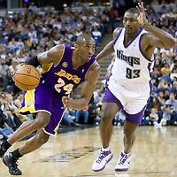 SACRAMENTO, CA - APRIL 06: Kobe Bryant #24 of the Los Angeles Lakers drives past Ron Artest #93 of the Sacramento Kings during a game at the Arco Arena on April 4, 2008 in Sacramento, CA. NOTE TO USER: User expressly acknowledges and agrees that, by downloading and or using this photograph, User is consenting to the terms and conditions of the Getty Images License Agreement. Mandatory Credit: 2008 NBAE (Photo by Chris Elise/NBAE via Getty Images)