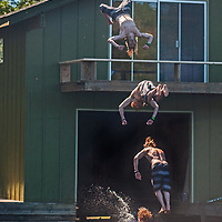 Ben Wiltsie dives from a balcony on a cabin at Lake of the Woods, Ontario, Canada,