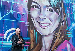 Edinburgh Science Festival, Edinburgh, Scotland, United Kingdom: <br /> Pictured: Amanda Tyndall, Edinburgh Science Festival Director, with a portrait by graffiti and mural artist Shona Hardie of  Natalie Duffield, one of the artworks in a street art trail called 'Women in STEM' which showcases the achievements of nine women who have contributed to the world of Science, Technology, Engineering and Maths (STEM). Natalie Duffield is CEO of InTechnology SmartCitie, a company that provides free WiFi in central Edinburgh. Shona has also painted many of the other portraits in the trail which are displayed in venues across the city. <br /> The 2021 Edinburgh Science Festival runs from 26 June – 11 July.<br /> Sally Anderson | EdinburghElitemedia.co.uk