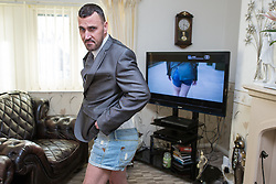 © Licensed to London News Pictures . Wythenshawe , Manchester , UK . FILE PICTURE DATED 23/03/2015 of WAYNE PHILLIPS ( 40 , from Wythenshawe ) . Phillips , who is currently (20th November 2015) working as a self-employed DPD delivery driver , became famous after pranking TV adverts and performing gags and stunts on YouTube and Vine , including a spoof of the Money Supermarket advert which he acted out in high heels and short shorts , near to his home , at Wythenshawe Precinct , in South Manchester and which went viral . Photo credit : Joel Goodman/LNP