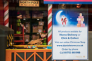 "A Christmas display in the window of Daniel department store is pictured during the second coronavirus lockdown on 9th November 2020 in Windsor, United Kingdom. Only retailers selling ""essential"" goods and services are permitted to open to the public during the second lockdown but the department store is currently able to offer goods for home delivery or click and collect."