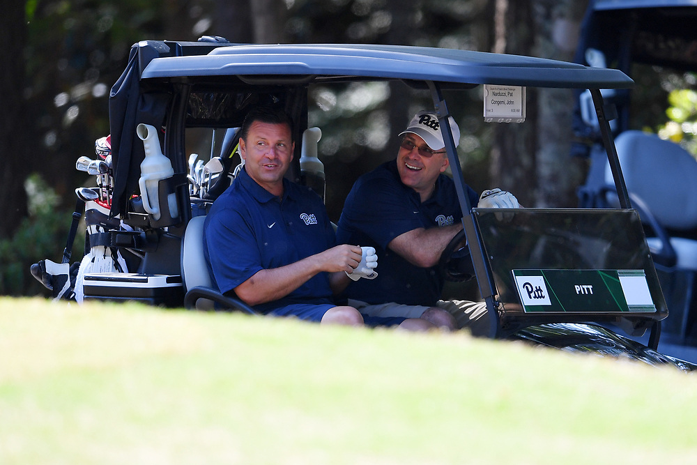 John Congemi and Pat Narduzzi in their cart during the Chick-fil-A Peach Bowl Challenge at the Oconee Golf Course at Reynolds Plantation, Sunday, May 1, 2018, in Greensboro, Georgia. (Dale Zanine via Abell Images for Chick-fil-A Peach Bowl Challenge)