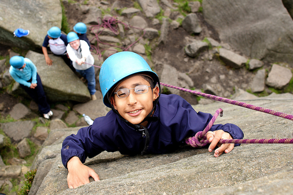 A young disabled boy rockclimbs in the Peak District National Park, England.<br /> Copyrighted work .Permission must be sort before use of this image..Alex Ekins .0114 2630277.07901883 994
