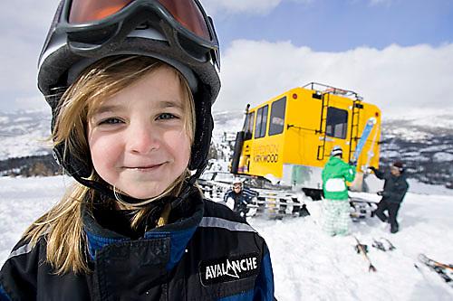 Kids riding snow cat and skiing at Kirkwood, CA.