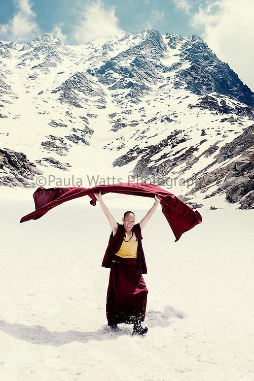 Himalayan Buddhist Tibetan monk in snow