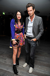 AMY MOLYNEAUX and PERCY PARKER at a dinner in honour of artist Ryan McGinley hosted by Alison Jacques to mark the occasion of his UK debut show 'Moonmilk' held at Paramount, Level 31, Centre Point, 103 New Oxford Street, London WC1 on 10th September 2009.