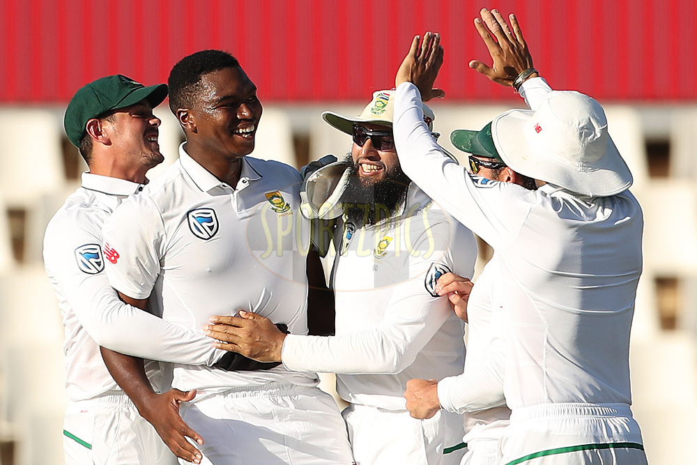 Lungi Ngidi of South Africa celebrates the the wicket of Virat Kohli (captain) of India during the fourth day of the second Sunfoil Test match between South Africa and India held at the Supersport park Cricket Ground in Centurion, South Africa on the 16th January 2018<br /> <br /> Photo by: Ron Gaunt / BCCI / SPORTZPICS