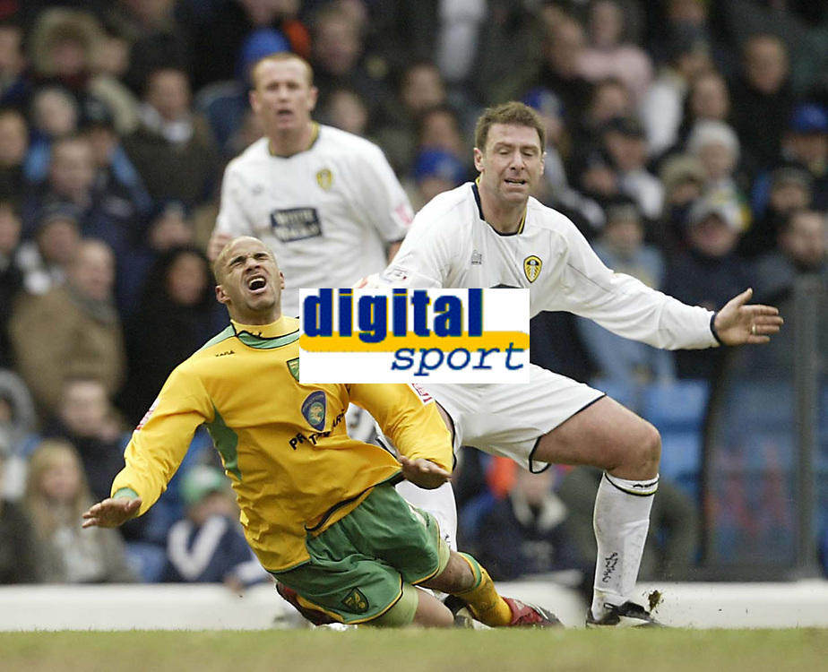 Photo: Aidan Ellis.<br /> Leeds United v Norwich City. Coca Cola Championship. 11/03/2006.<br /> Leeds Paul Butler brings down Norwich's Leon McKenzie