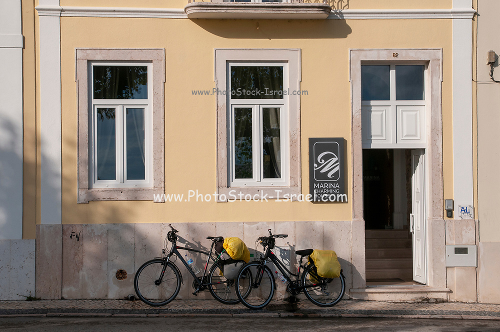 Touring bicycles are parked in front of a renovated building (now guest house) facing the waterfront, Figueira da Foz, Portugal