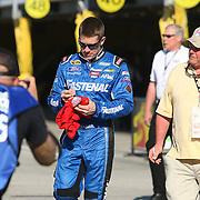 Driver Carl Edwards signs autographs during the  56th Annual NASCAR Daytona 500 practice session at Daytona International Speedway on Wednesday, February 19, 2014 in Daytona Beach, Florida.  (AP Photo/Alex Menendez)