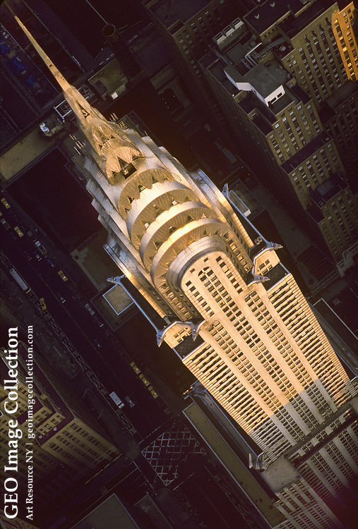 Aerial at dawn of the Chrysler Building skyscraper in midtown Manhattan, New York. At 1,047 the famous Art Deco masterpiece is the world's tallest brick building and completed in 1930 to design by architect William Van Alen for automobile tycoon Walter Chrysler. The terraced crown features radiating arches with vaulted triangular windows is clad in nirosta, an early stainless steel made by Krupp.