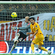 Galatasaray's Engin Baytar (R) and Sivasspor's goalkeeper Milan Borjan (L) during their Turkish Superleague soccer match Galatasaray between Sivasspor at the Turk Telekom Arena at Aslantepe in Istanbul Turkey on Saturday 26 November 2011. Photo by TURKPIX