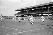 09/05/1965<br /> 05/09/1965<br /> 9 May 1965<br /> National Hurling League Semi-Final: Waterford v Tipperary at Croke Park, Dublin.<br /> Tipperary goalie, J. O'Donoghue, comes out to stop a fast ball from Waterford as S. Power moves in to follow up.
