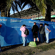 Spectators watch through the holes in the fence during a Rugby World Cup match at Gosford, NSW, Australia.