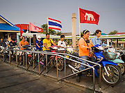 24 MARCH 2015 - MAHACHAI, SAMUT SAKHON, THAILAND: People wait on their motorcycles to board a ferry to cross the Tha Chin river in Mahachai (also called Samut Sakhon) in Samut Sakhon province, Thailand.     PHOTO BY JACK KURTZ