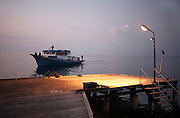 Setting off at dawn from a jetty to fish for Yellow Fin Tuna aboard a traditional dhoni fishing boat on the Indian Ocean