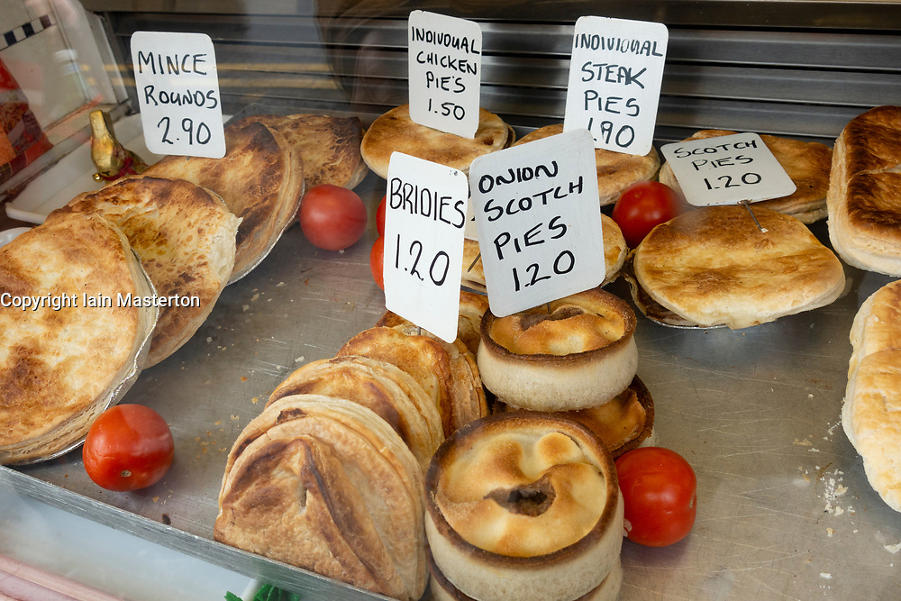 Traditional Scottish pies and brides for sale in The Country Shop butchers on High Street in Glasgow East End, Scotland, UK