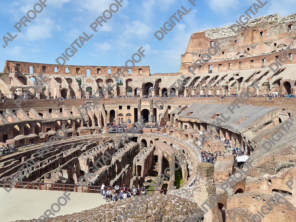 Inside view of the arena Colosseum with tourists during the day