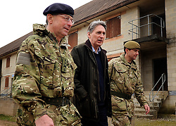 © Licensed to London News Pictures. 09/03/2012. Copedown Hill, UK. (Left to right) David Richards, Chief of Defence Staff, Philip Hammond, Secretary of Defence and Brigadier Doug Chalmers.  Secretary of Defence Philip Hammond visits troops who are being deployed to Afghanistan next month. The 12th Mechanized Brigade (12 Mech Bde) at Copehill Down, Salisbury Plain Training Area, Wiltshire, on FRIDAY 09 MARCH 2012, as it prepares to deploy to Helmand Province, Afghanistan, on Operation Herrick 16, in the Spring of this year. The Brigade were performing a dynamic demonstration of combined Afghan/ISAF operations supported by surveillance assets and casualty evacuation capability. Tornado GR4 fast jest ground support was also displayed.. Photo credit : Stephen SImpson/LNP