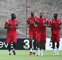 20100817: BRAGA, PORTUGAL - Sevilla FC training session before UEFA Champions League 2010/2011 Play-off match against SC Braga. In picture: Romaric, Kanoute, Luis Fabiano and Zokora. PHOTO: CITYFILES