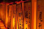 A wall of yellow lanterns, each containing the name of a fallen serviceman, during the Mitama matsuri in remembrance of Japan`s war dead at the controversial Yasukuni Shrine in Tokyo, Japan. Sunday,July 13th 2008