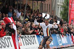 Tony Martin of Germany celebrates as he crosses the finishline to win the Elite Men's Time Trial on day three of the UCI Road World Championships on September 21, 2011 in Copenhagen, Denmark. (Photo by Marjan Kelner / Sportida Photo Agency)