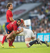 Twickenham, England.  Alexandre DULIN, witht he ball tackled by George KRUIS, during the QBE International. England vs France [World cup warm up match]  Saturday.  15.08.2015,  [Mandatory Credit. Peter SPURRIER/Intersport Images].