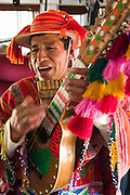 A musician performs Andean music for tourists inside the train that runs between Cuzco and Puno, Peru on August 31, 2005.