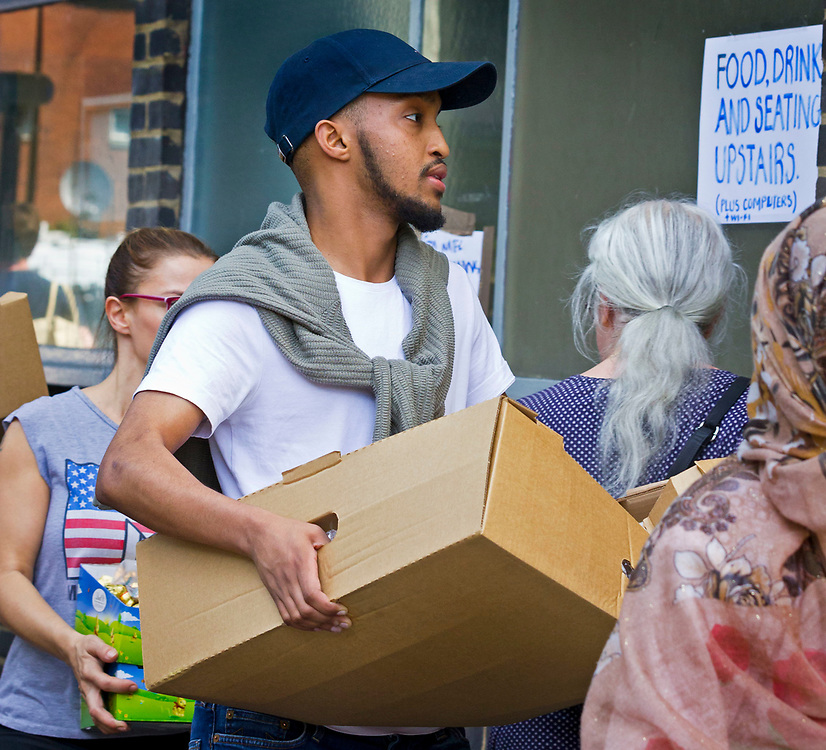 14 June 2017 taken between the hours of 12.22 - 14.49<br /> Locals/residents/volunteers carrying endless food and water donations to the various emergency centres.<br /> <br /> The Grenfell Tower fire occurred on 14 June 2017 at the 24-storey, 220-foot-high (67 m), tower block of public housing flats in North Kensington, Royal Borough of Kensington and Chelsea, West London. It caused at least 80 deaths and over 70 injuries. A definitive death toll is not expected until at least 2018. As of 5 July 2017, 21 victims had been formally identified by the Metropolitan Police. Authorities were unable to trace any surviving occupants of 23 of the flats.  ( Source Wikipedia}