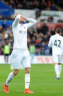Swansea's Gylfi Sigurdsson holds his head in his hands after his shot goes just wide of the goal. Premier league match, Swansea city v Burnley at the Liberty Stadium in Swansea, South Wales on Saturday 4th March 2017.<br /> pic by  Carl Robertson, Andrew Orchard sports photography.