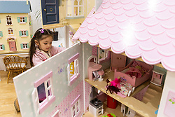 A little girl plays with a dolls' House at the Toy Fair at Kensington Olympia in London, the UK's largest dedicated game and hobby exhibition featuring the hottest and most anticipated products for the year ahead. London, January 22 2019.