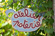 Pottery sign for craft shop in quaint town of Castelmoron d'Albret in Bordeaux region, Gironde, France