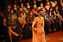 Lebanese women are seen at a runway show for fashion designer Nadine Mezher, Beirut, Lebanon, March 25, 2006. The show, held at Buddha Bar nightclub, is part of Beirut Fashion Week.
