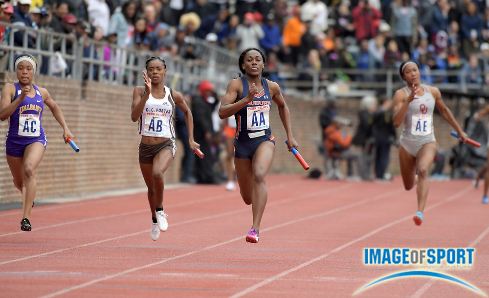 Apr 27, 2018; Philadelphia, PA, USA; Natalliah Whyte (AA)runs the anchor leg on the Auburn women's 4 x 100m relay that won the Championship of America race in 44.14  during the 124th Penn Relays at Franklin Field. From left: Stephanie Osuji (Albany), Ashley Williams (G.C. Foster), White and Leya Buchanan (Oklahoma).