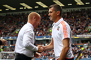 Burnley Manager Sean Dyche (l) and Brentford Manager Marinus Dijkhuizen shake hands prior to kick off. Skybet football league championship match, Burnley  v Brentford at Turf Moor in Burnley, Lancs on Saturday 22nd August 2015.<br /> pic by Chris Stading, Andrew Orchard sports photography.