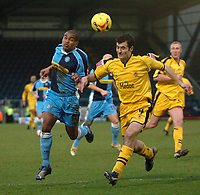 Photo: Tony Oudot.<br />Wycombe Wanderers v Notts County. Coca Cola League 2. 10/02/2007.<br />Jermaine Easter of Wycombe challenges the ball with Mike Edwards of Notts County