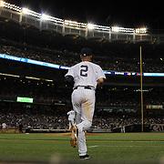 Derek Jeter, New York Yankees, heads onto the field during the New York Yankees Vs Cincinnati Reds baseball game at Yankee Stadium, The Bronx, New York. 18th July 2014. Photo Tim Clayton