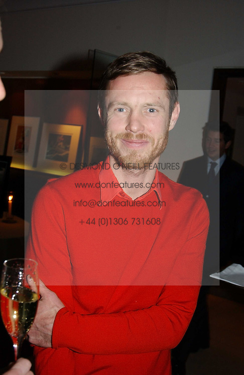 MR TOM CONRAN at a party to celebrate a book of work by artist Jack Vettriano held at The Bluebird Club & Dining Room, 350 Kings Road, London on 7th December 2004.<br /><br />NON EXCLUSIVE - WORLD RIGHTS