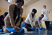 Workers from children's care homes in Guateng, South Africa practice basic life support and CPR. Their teacher is Daryl, a retired nurse who now volunteers for Bigshoes Foundation, a charity dedicated to improving health facilities for children living in local communities and children's homes across South Africa.