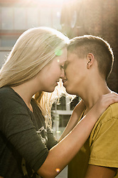 Teenage couple kissing each other, close up