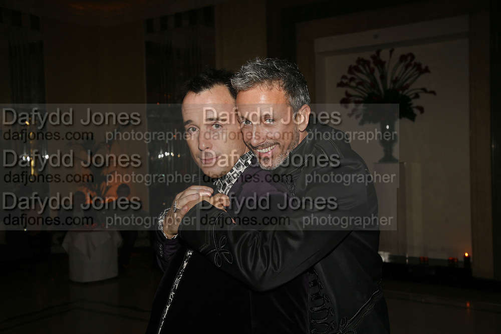 David Furnish and Patrick Cox, Work by Mexican artist, Gabriel Orozco. Gallery opening & private view at new White Cube space, 25-26 Mason's Yard, London and afterwards at Claridges. London. 27 September 2006. <br /> -DO NOT ARCHIVE-© Copyright Photograph by Dafydd Jones 66 Stockwell Park Rd. London SW9 0DA Tel 020 7733 0108 www.dafjones.com
